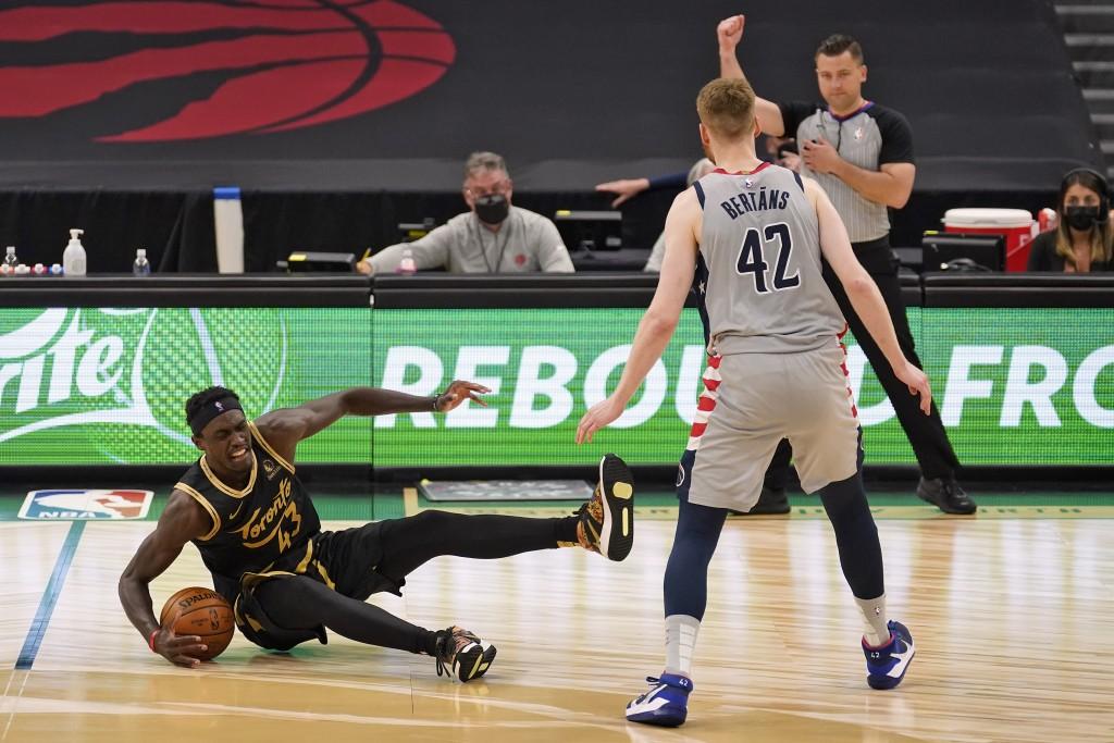 Toronto Raptors forward Pascal Siakam (43) gets fouled by Washington Wizards forward Davis Bertans (42) during the second half of an NBA basketball ga...