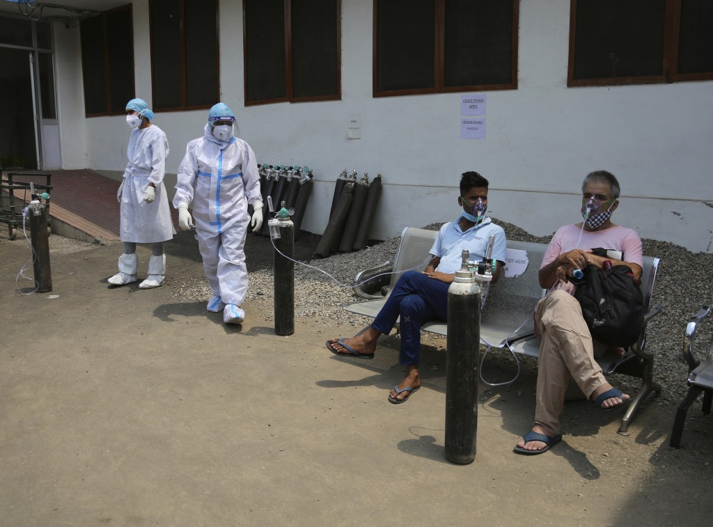 COVID-19 patients receive oxygen outside a government run hospital in Jammu, India, Friday, May 7, 2021. With coronavirus cases surging to record leve...