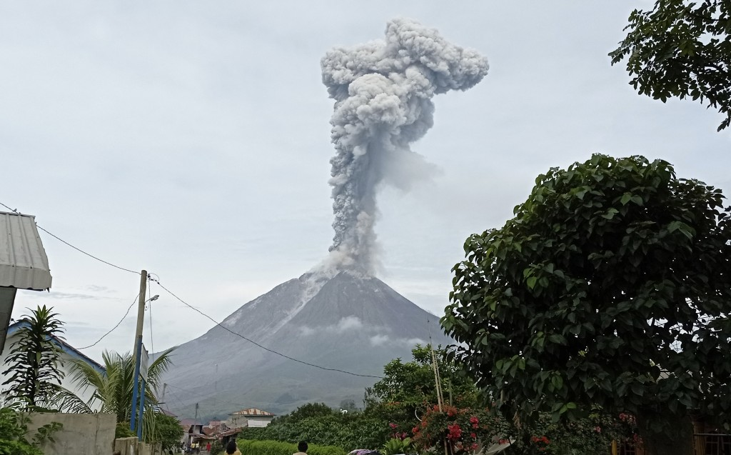 Mount Sinabung releases volcanic materials during an eruption in Karo, North Sumatra, Indonesia, Friday, May 7, 2021. Sinabung is among more than 120 ...