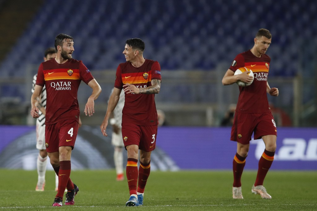 Roma's Bryan Cristante, left, celebrates after scoring his side's second goal with his teammate Roger Ibanez during the Europa League semifinal, secon...