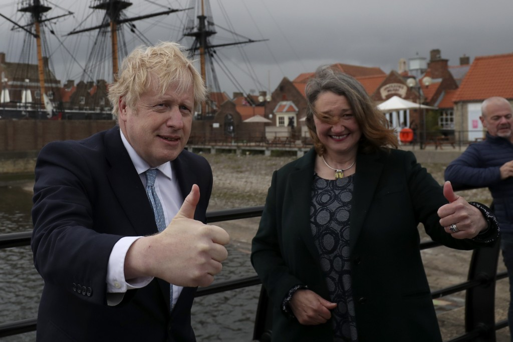 British Prime Minister Boris Johnson poses for photographers with Jill Mortimer, the winning Conservative Party candidate of the Hartlepool by-electio...