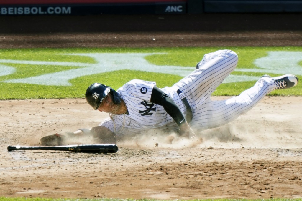 New York Yankees' Gleyber Torres slides home to score on a single by Aaron Hicks in the eight inning of a baseball game against the Houston Astros, Th...