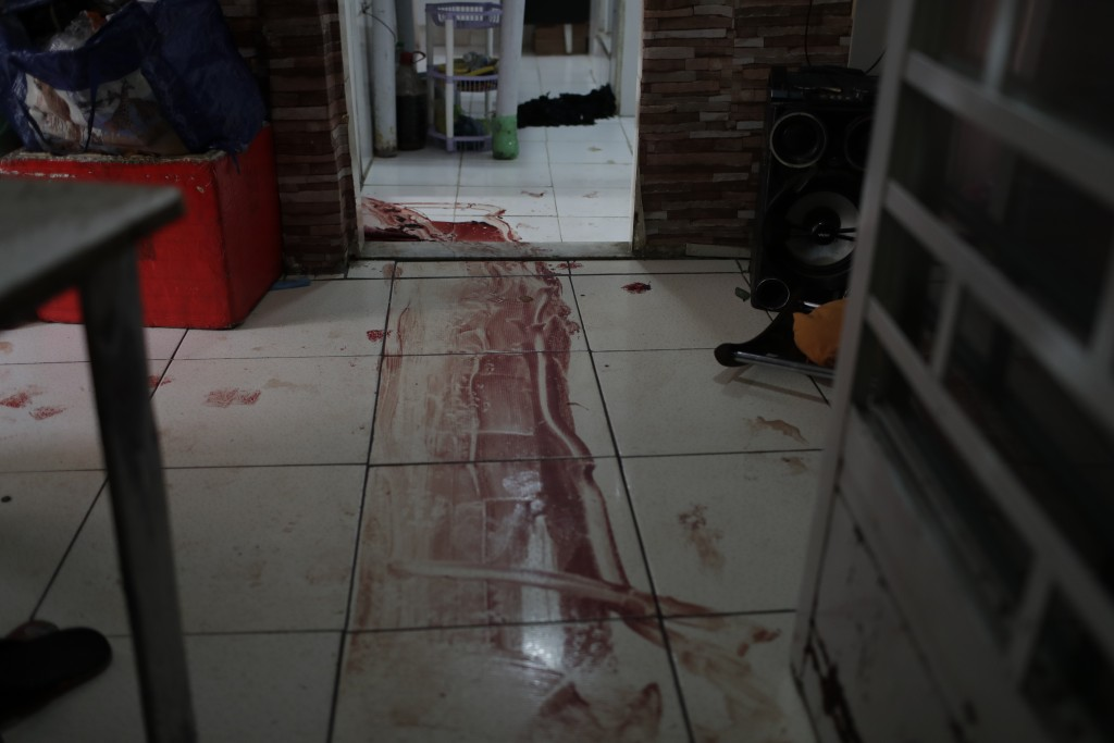 Blood covers the floor of a home during a police operation targeting drug traffickers in the Jacarezinho favela of Rio de Janeiro, Brazil, Thursday, M...