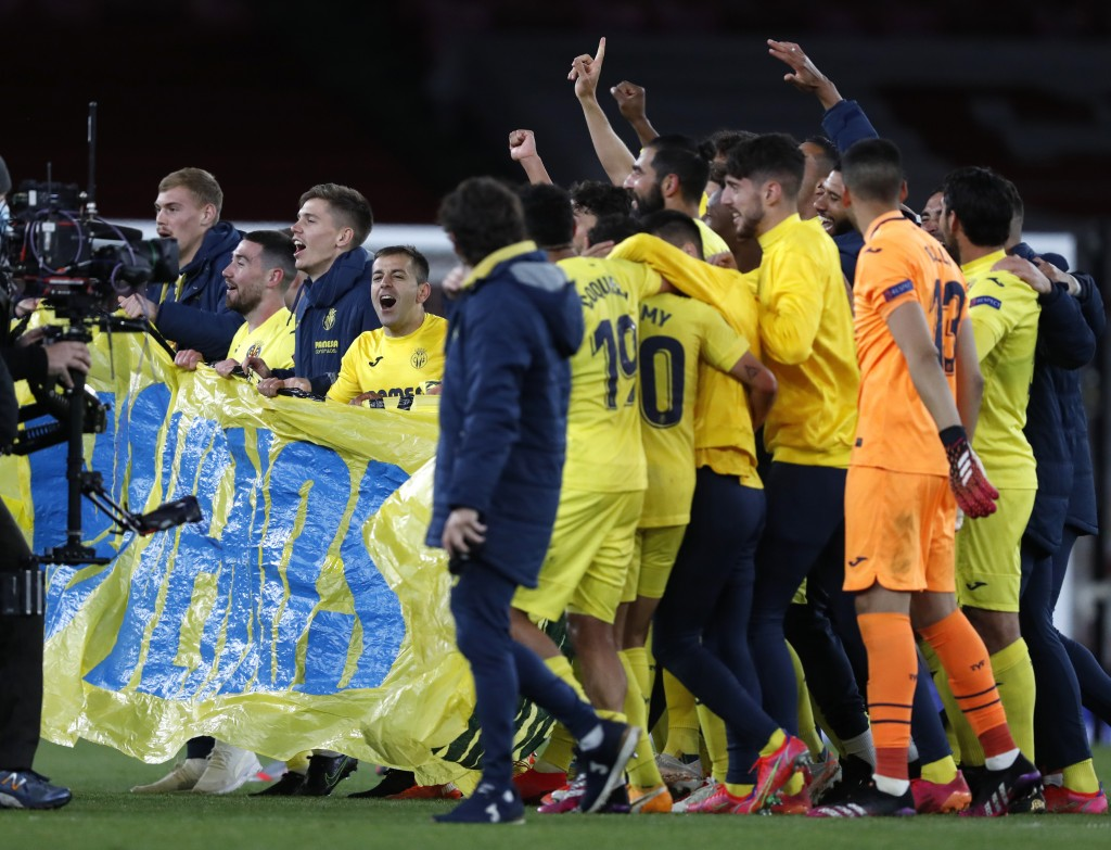 Villarreal players celebrate at the end of the Europa League semifinal second leg soccer match between Arsenal and Villarreal at the Emirates stadium ...
