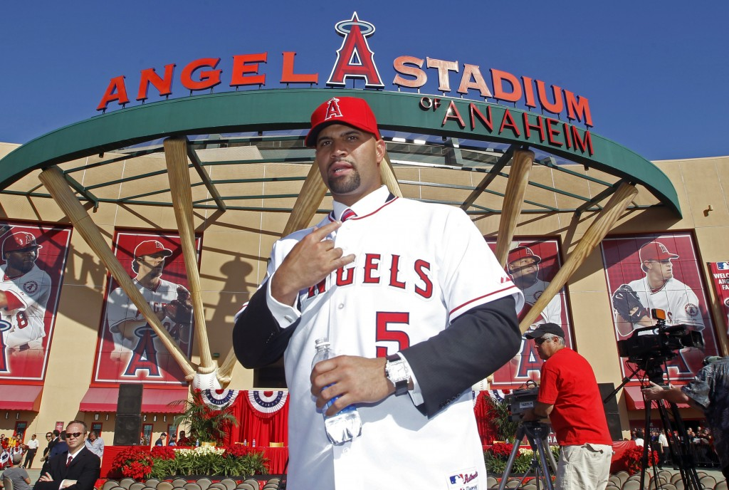 FILE - In this Dec. 10, 2011, file photo, Los Angeles Angels' Albert Pujols wears his new jersey after a news conference to introduce Pujols and C.J. ...