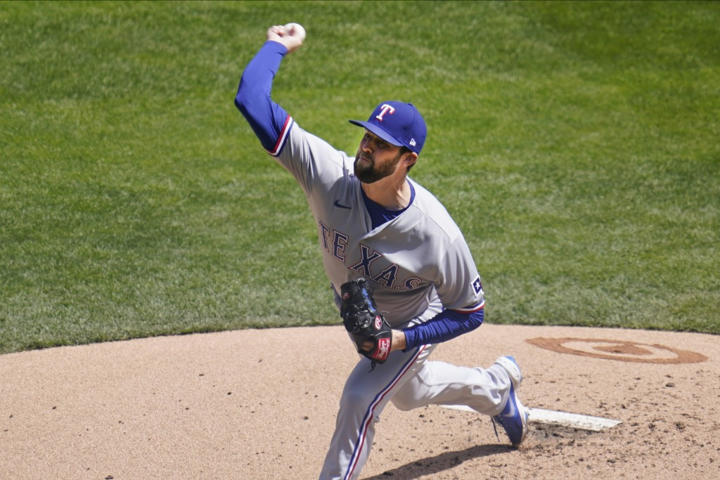 Texas Rangers' pitcher Jordan Lyles throws against the Minnesota Twins in the first inning of a baseball game, Thursday, May 6, 2021, in Minneapolis. ...