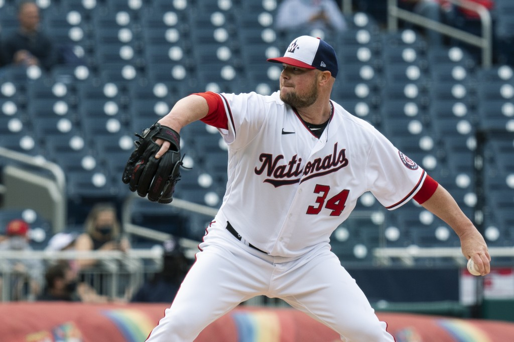 Washington Nationals starting pitcher Jon Lester (34) throws during the first inning of a baseball game against the Atlanta Braves in Washington, Thur...