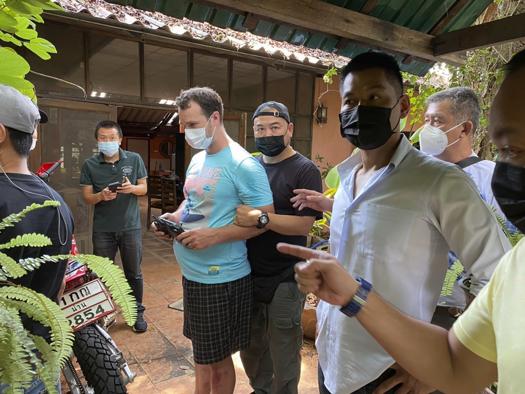 In this Thursday, May 6, 2021, photo released by the Thai Provincial Police Region 5, police arrest and interrogate American citizen Jason Matthew Bal...