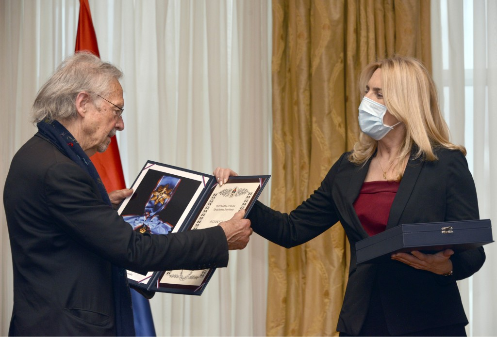 Austrian author Peter Handke, left, receives the Order of the Republika Srpska from President of Republika Srpska Zeljka Cvijanovic during the ceremon...