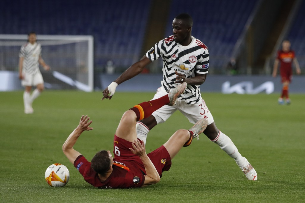 Roma's Edin Dzeko, bottom, is challenged by Manchester United's Eric Bailly during the Europa League semifinal, second leg soccer match between Roma a...