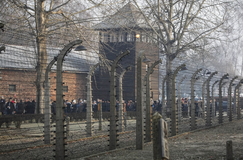 FILE- In this file photo taken Jan. 27, 2020, people are seen arriving at the site of the Auschwitz-Birkenau Nazi German death camp, where more than 1...