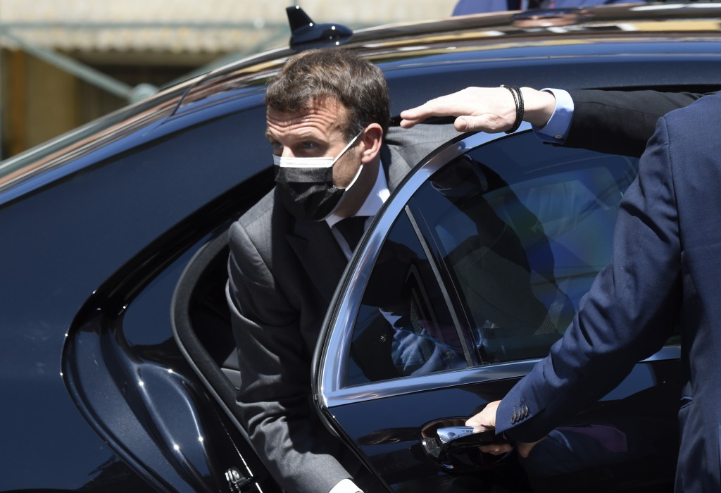 French President Emmanuel Macron arrives for an EU summit at the Alfandega do Porto Congress Center in Porto, Portugal, Friday, May 7, 2021. European ...