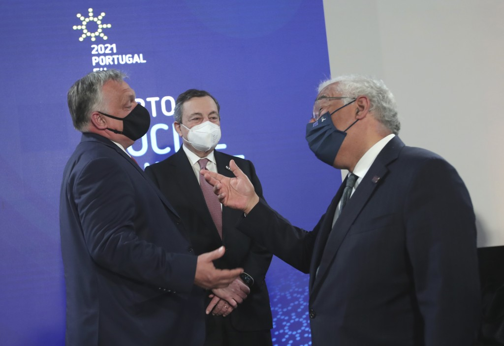 Portugal's Prime Minister Antonio Costa, right, speaks with Hungary's Prime Minister Viktor Orban, left, and Italy's Prime Minister Mario Draghi, cent...