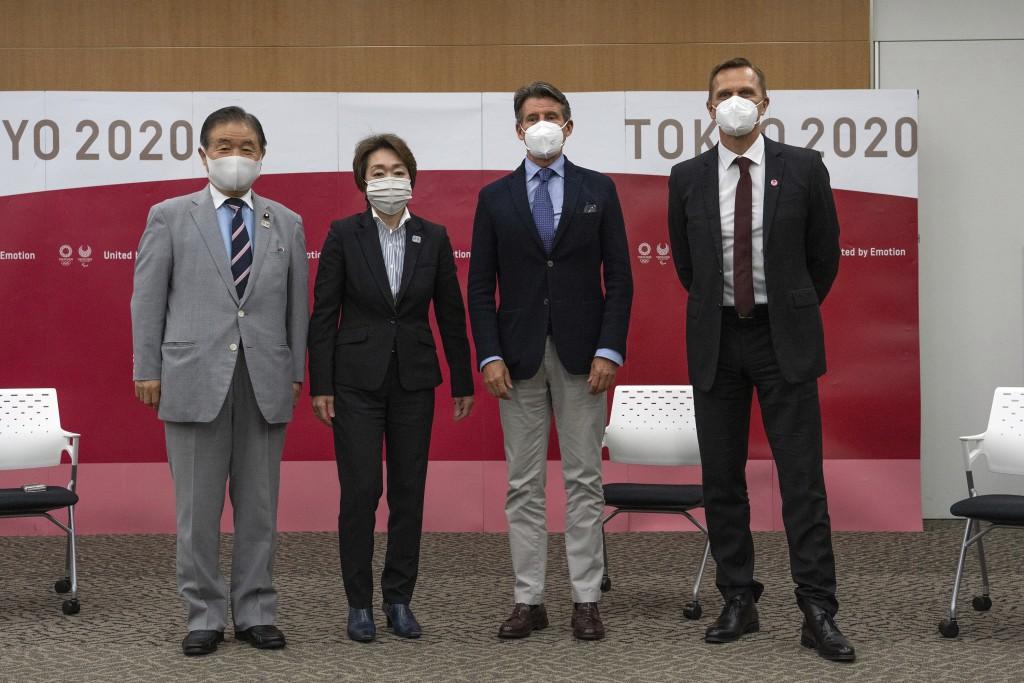 Toshiaki Endo, left, vice president of the Tokyo 2020 Organizing Committee, Seiko Hashimoto, second left, president of the Tokyo 2020 Organizing Commi...
