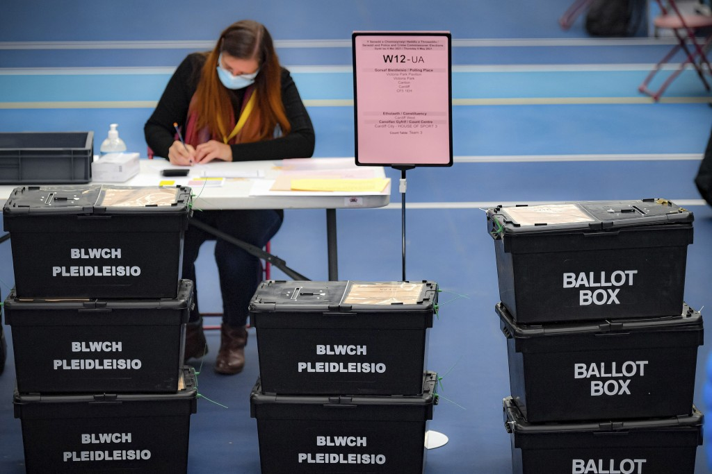 Ballot boxes arrive for counting votes for the Welsh Parliamentary Elections at the Cardiff House of Sport, Cardiff, Wales, Friday May 7, 2021.  The c...