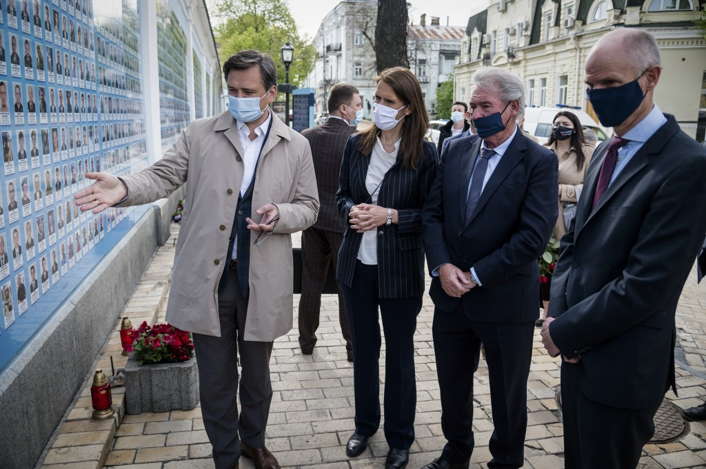Left to right, Ukrainian Foreign Minister Dmytro Kuleba, Belgium's Foreign Minister Sophie Wilmes, Luxembourg's Foreign Minister Jean Asselborn and Fo...