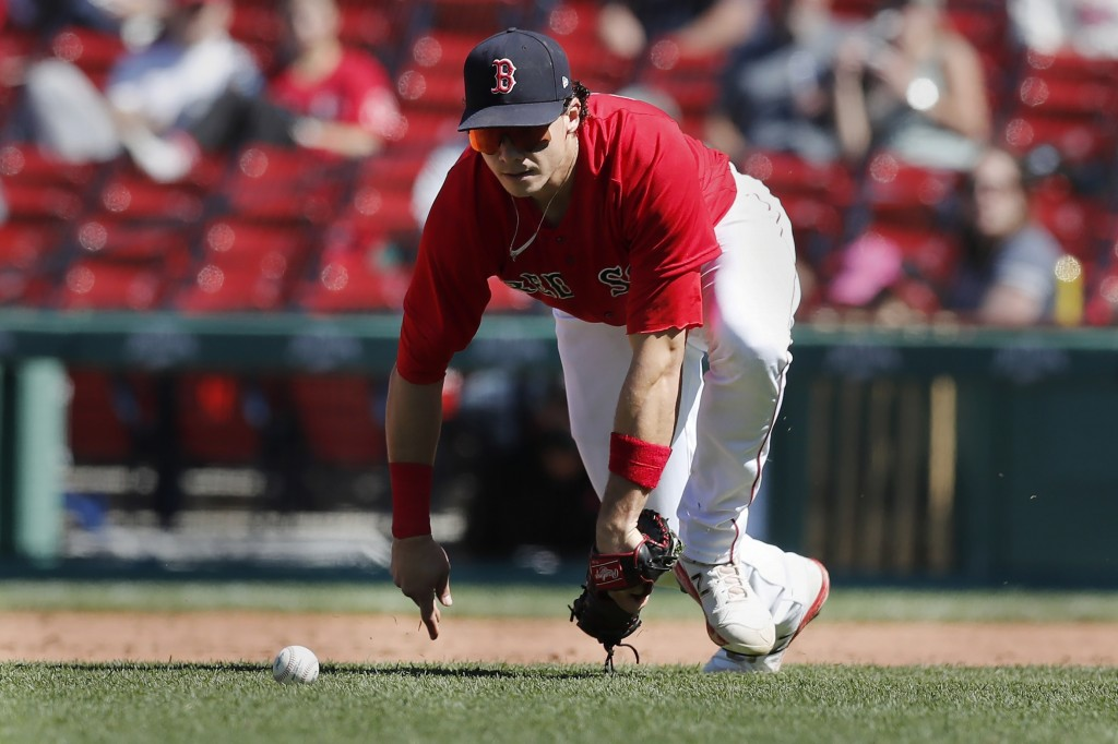 Boston Red Sox's Bobby Dalbec fields the ball on an RBI single by Detroit Tigers' Niko Goodrum during the fifth inning of a baseball game, Thursday, M...