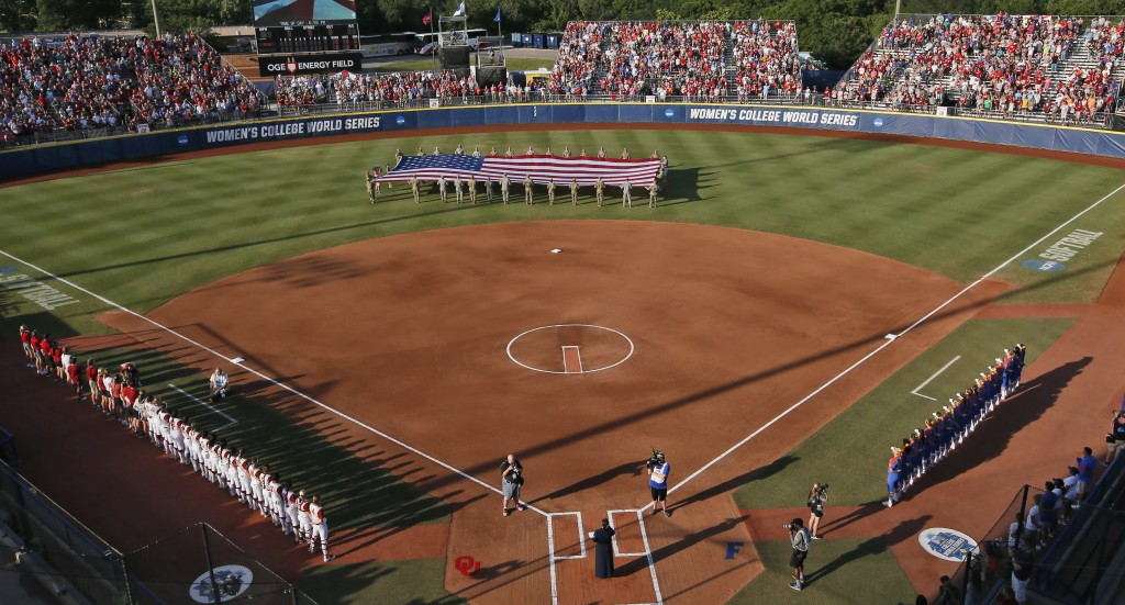 FILE - A large flag is unfurled in the outfield before the second game of the best-of-three championship series between Florida and Oklahoma in the NC...