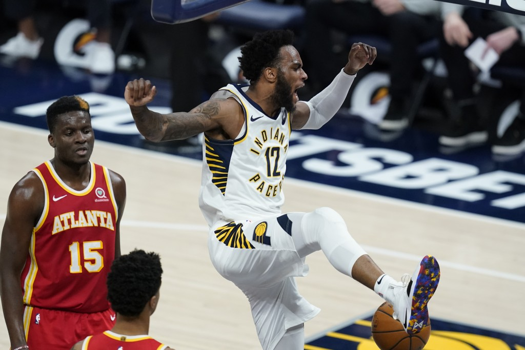 Indiana Pacers' Oshae Brissett (12) reacts after a dunk during the second half of the team's NBA basketball game against the Atlanta Hawks, Thursday, ...
