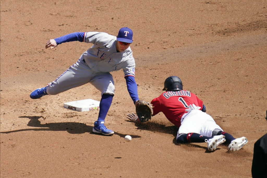 Minnesota Twins' Nick Gordon, right, steals second base as the throws gets past Texas Rangers second baseman Nick Solak in the second inning of a base...