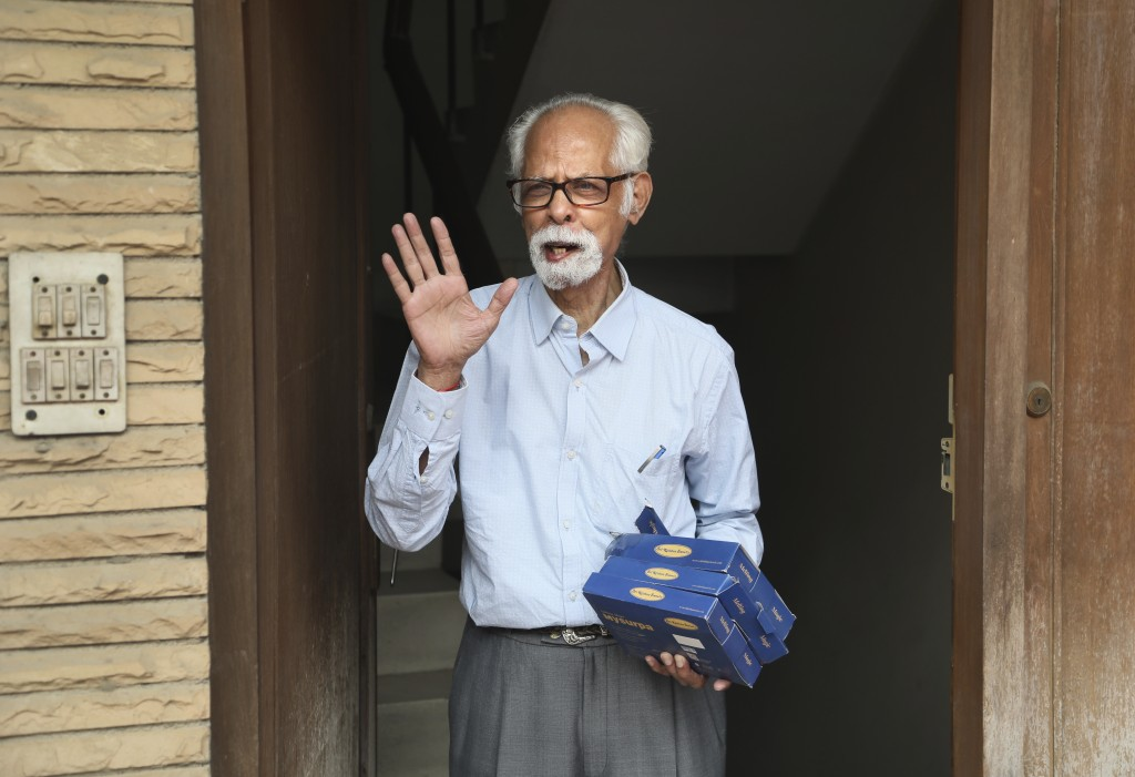 FILE - In this Nov. 8, 2020, file photo, Vice President Kamala Harris' maternal uncle, Balachandran Gopalan, talks to media outside his house, in New ...