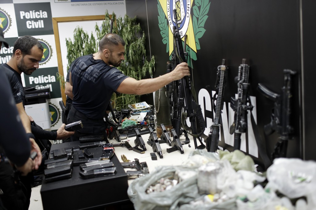 Weapons and drugs seized during a police raid are displayed for the press at city police headquarters in Rio de Janeiro, Brazil, Thursday, May 6, 2021...