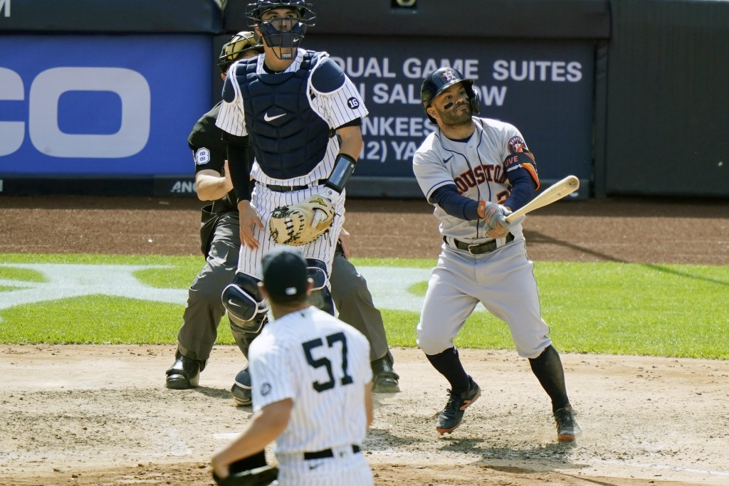 Houston Astros' Jose Altuve, New York Yankees relief pitcher Chad Green (57) and Yankees catcher Kyle Higashioka watch Altuvé's eighth-inning, three-r...