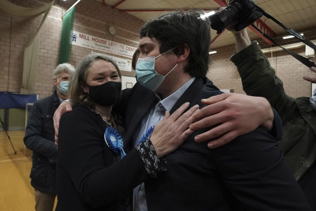Conservative's Jill Mortimer, center left, receives a hug after being declared winner in the Hartlepool parliamentary by-election at Mill House Leisur...
