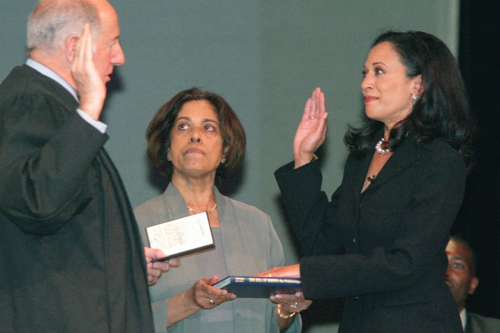 FILE - In this Jan. 8, 2004, file photo, San Francisco's new district attorney, Kamala Harris, right, receives the oath of office from California Supr...