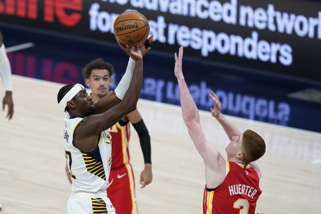 Indiana Pacers' Caris LeVert (22) shoots over Atlanta Hawks' Kevin Huerter (3) during the second half of an NBA basketball game Thursday, May 6, 2021,...