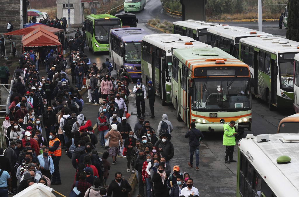 Commuters, most who use the Line 12 subway daily to get across the city, line up to board buses on the south side of Mexico City, Thursday, May 6, 202...