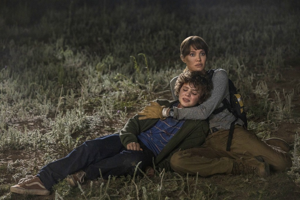 """This image released by Warner Bros. Entertainment shows Angelina Jolie and Finn Little in a scene from """"Those Who Wish Me Dead."""" (Emerson Miller/Warne..."""