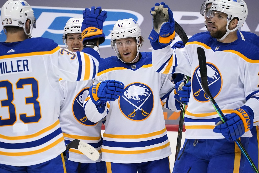 Buffalo Sabres' Drake Caggiula (91) celebrates his second goal of an NHL hockey game during the second period against the Pittsburgh Penguins in Pitts...