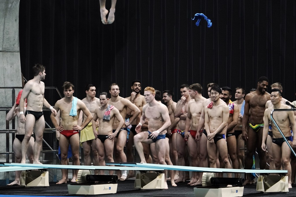 Athletes warm up prior to the men's synchronized 10-meter platform preliminary at the FINA Diving World Cup Saturday, May 1, 2021, at the Tokyo Aquati...