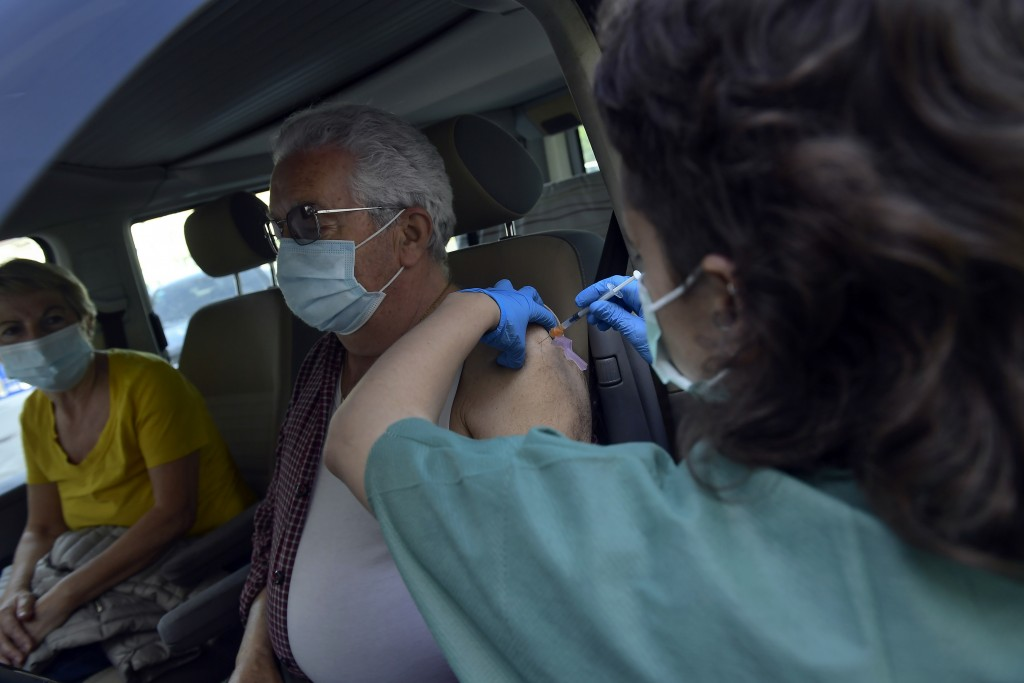 Manuel Santamaria, 76, receives a shot of Pfizer vaccine during a COVID-19 vaccination campaign, in Pamplona, northern Spain, Friday, May 7, 2021.(AP ...