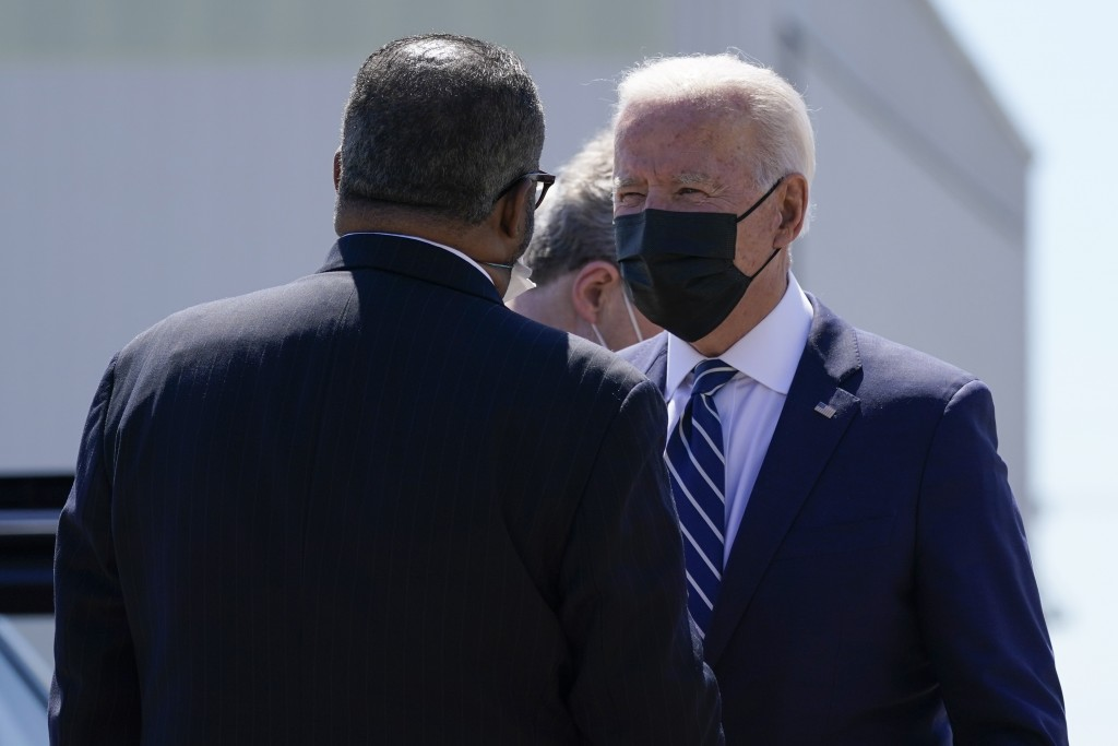President Joe Biden greets Rep.-elect Troy Carter, D-La., upon arrival at Louis Armstrong New Orleans International Airport, Thursday, May 6, 2021, in...