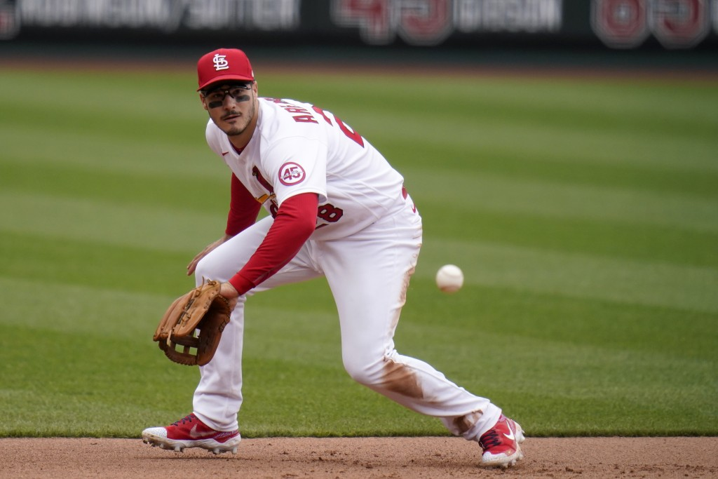 St. Louis Cardinals third baseman Nolan Arenado handles a grounder by New York Mets' Pete Alonso during the fifth inning of a baseball game Thursday, ...