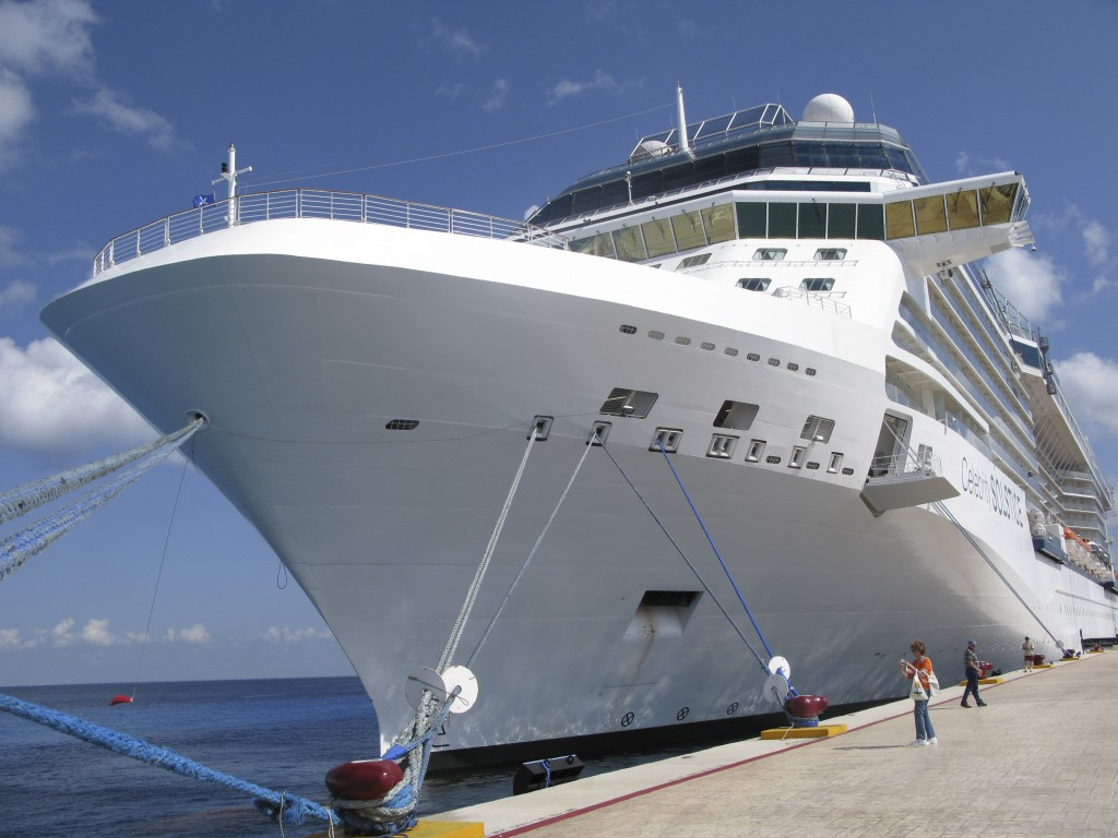FILE - In this June 9, 2010 file photo, the Celebrity cruise ship Solstice is docked in Cozumel, Mexico. With tourism shattered by the COVID-19 pandem...