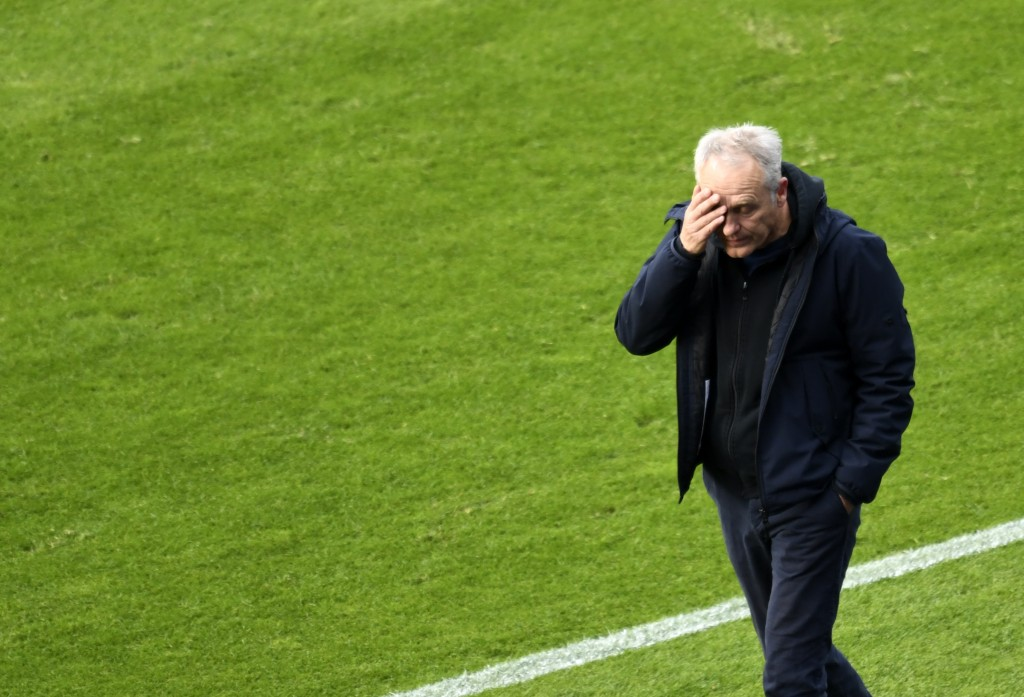Freiburg's head coach Christian Streich reacts during the German Bundesliga soccer match between Hertha BSC Berlin and SC Freiburg in Berlin, Germany,...