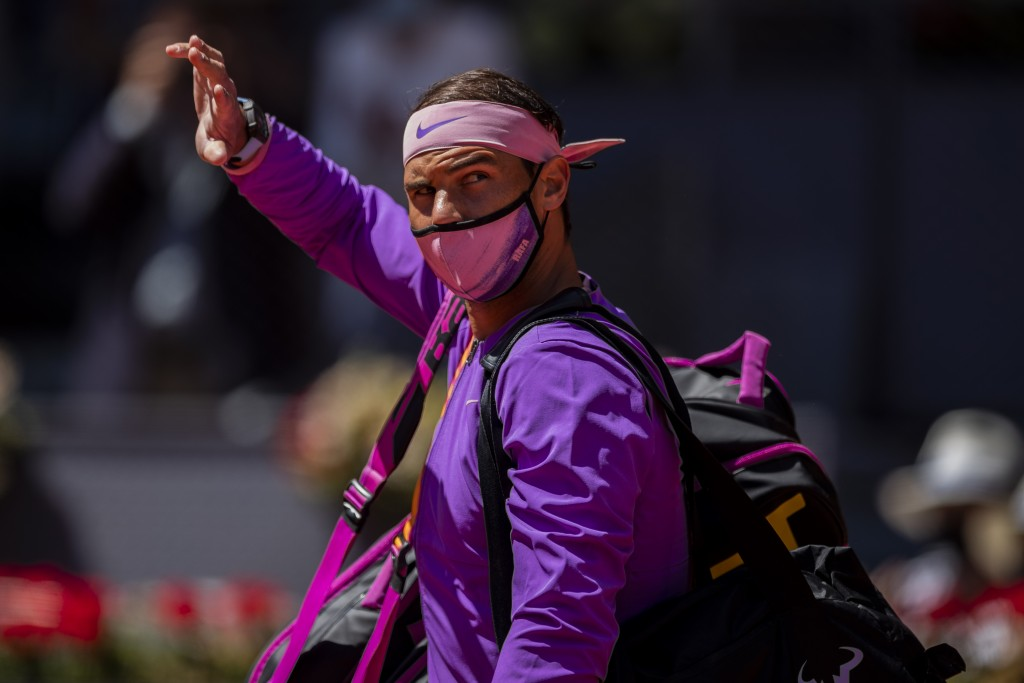 Spain's Rafael Nadal waves to spectators prior his tennis match against Germany's Alexander Zverev at the Mutua Madrid Open tennis tournament in Madri...