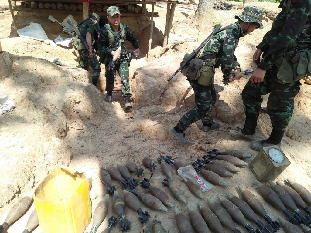 In this photo provided by Karen National Liberation Army, a Karen National Liberation Army soldier holds a mortar shell found at a Myanmar military ou...