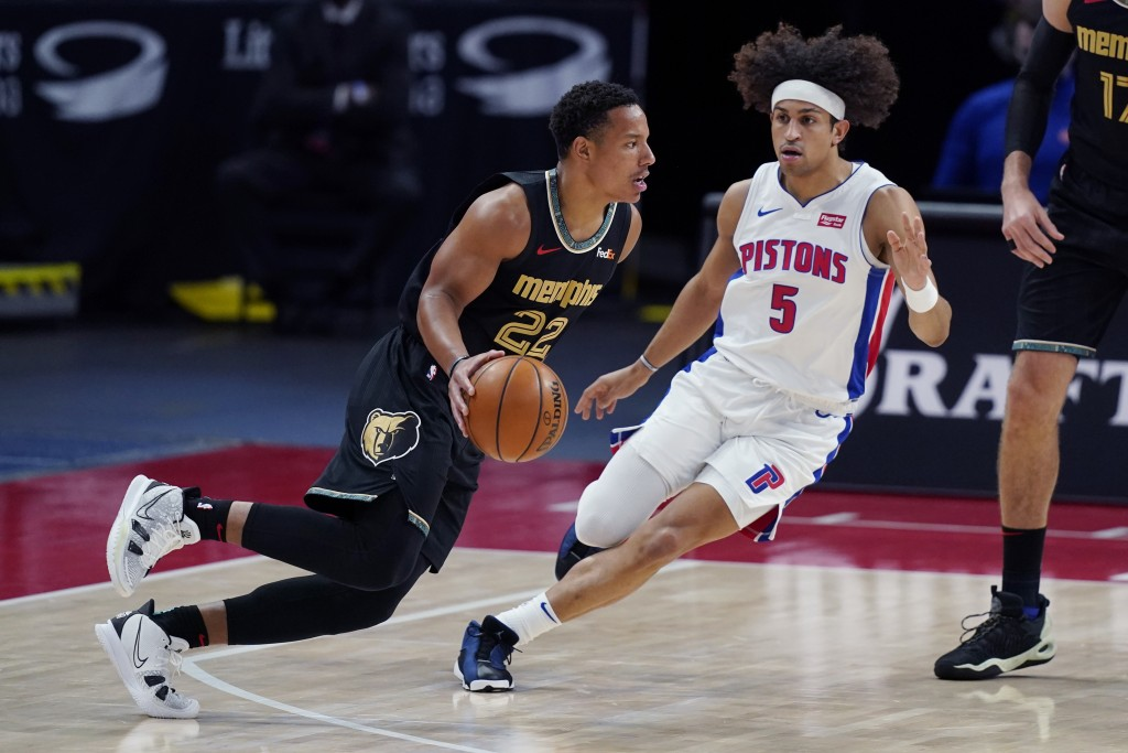 Memphis Grizzlies guard Desmond Bane (22) drives as Detroit Pistons guard Frank Jackson (5) defends during the first half of an NBA basketball game, T...