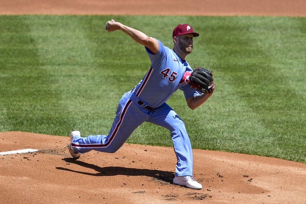 Philadelphia Phillies starting pitcher Zack Wheeler throws the ball during the first inning of a baseball game against the Milwaukee Brewers, Thursday...
