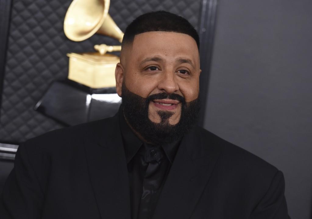 "FILE - DJ Khaled arrives at the 62nd annual Grammy Awards on Jan. 26, 2020, in Los Angeles. DJ Khaled latest maximalist album, ""Khaled Khaled,"" featur..."