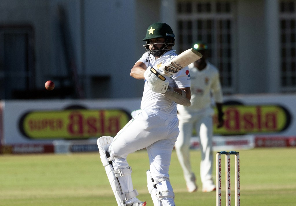 Pakistan batsman Azhar Ali plays a shot during the second test cricket match against Zimbabwe at Harare Sports Club, Friday, May, 7, 2021.(AP Photo/Ts...