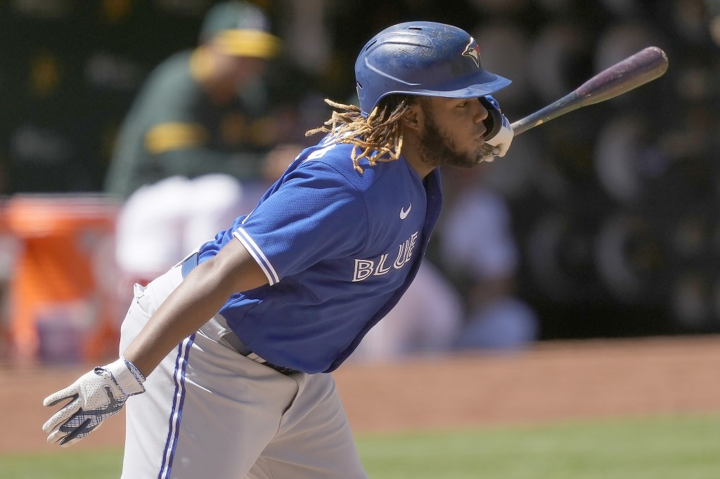 Toronto Blue Jays' Vladimir Guerrero Jr. (27) hits a single to load the bases during the sixth inning of a baseball game against the Oakland Athletics...