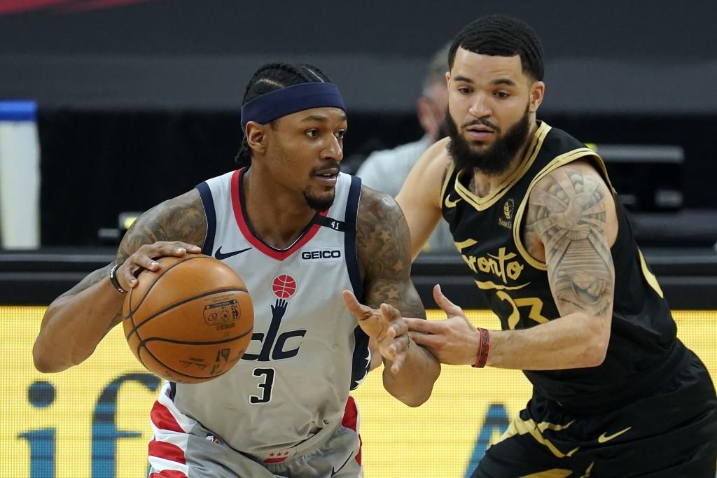 Washington Wizards guard Bradley Beal (3) drives around Toronto Raptors guard Fred VanVleet (23) during the first half of an NBA basketball game Thurs...