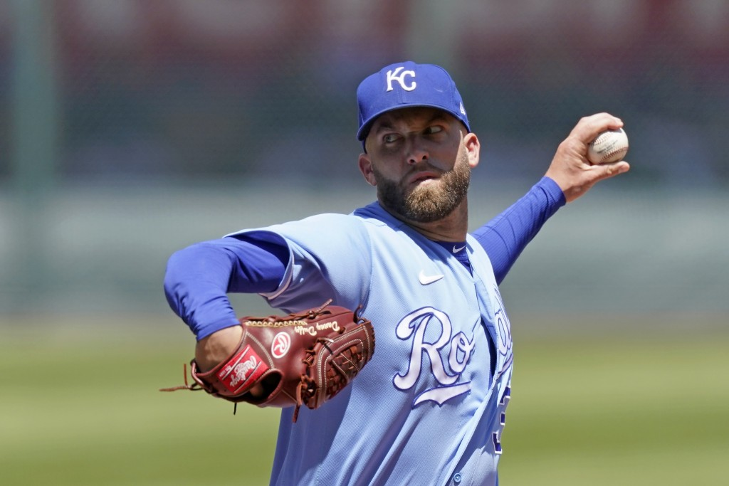 Kansas City Royals starting pitcher Danny Duffy throws during the first inning of a baseball game against the Cleveland Indians Thursday, May 6, 2021,...
