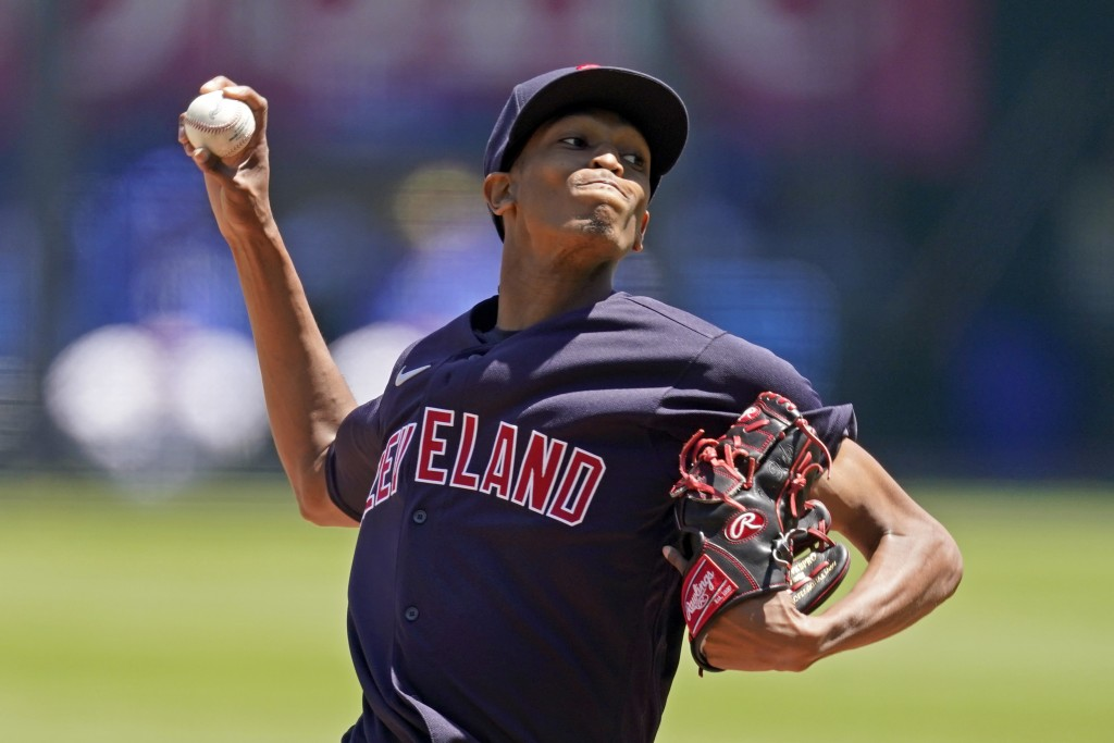 Cleveland Indians starting pitcher Triston McKenzie throws during the first inning of a baseball game against the Kansas City Royals Thursday, May 6, ...