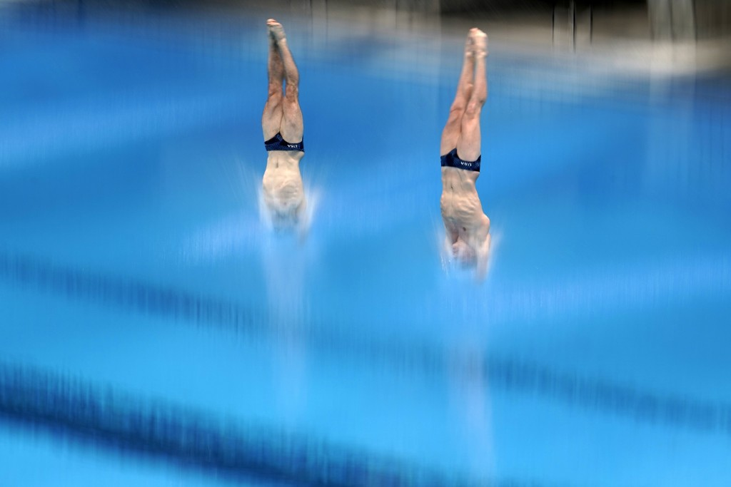 United States' Michael Hixon and Andrew Capobianco perform a dive during the men's synchronized 3-meter springboard preliminaries at the FINA Diving W...